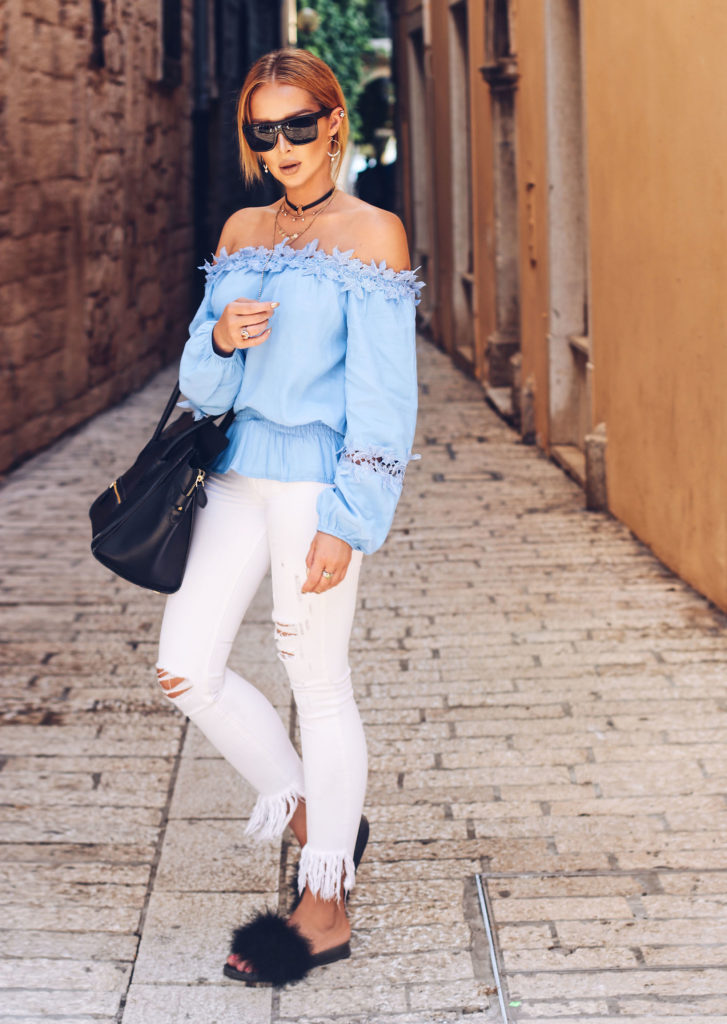 If there was a part I, there has to be a part II. So there you go, another cute blue top that I've paired with summery white destroyed denims and fluffy shoes and a Celine bag in Croatia!